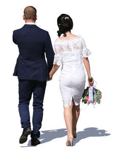 couple in formal clothes walking hand in hand