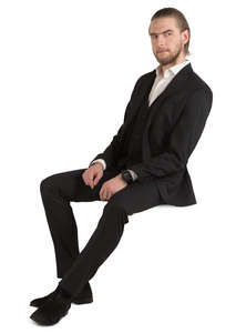 man in a black suit sitting
