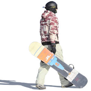 young man walking and carrying a snowboard