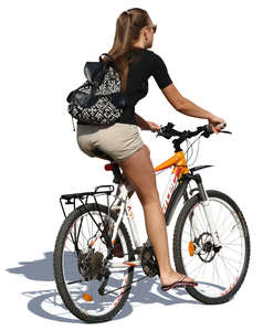woman riding a bicycle in the summer