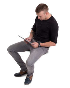 man sitting with a tablet seen from above
