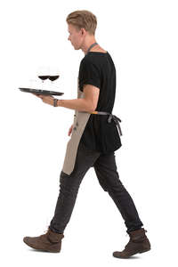 male waiter with a tray walking
