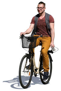 man riding a bicycle in the summer
