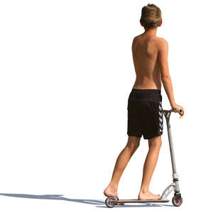 young boy in shorts riding a scooter