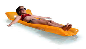 teenage girl floating on a swimming mattress