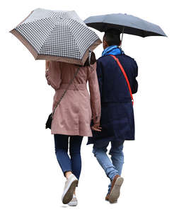 couple with umbrellas walking in the rain