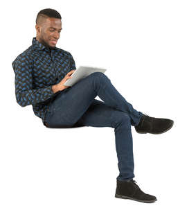 african man sitting and working with tablet