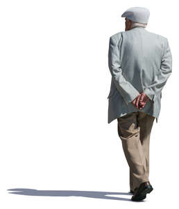 older man with a hat walking