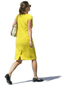 woman in a yellow dress walking