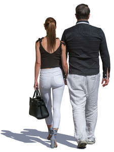 man and woman in black and white walking hand in hand