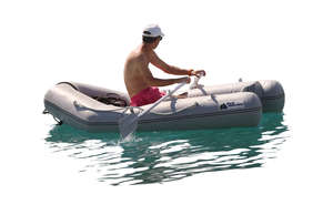 man rowing an inflatable boat