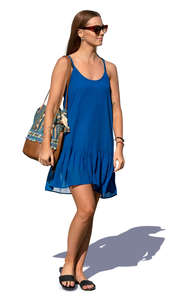 woman in a blue summer dress walking