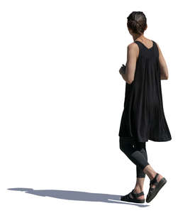 woman in a black summer dress walking