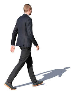 young man in a dark outfit walking