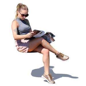 woman with sunglasses sitting and reading