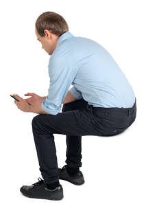 young man sitting and texting
