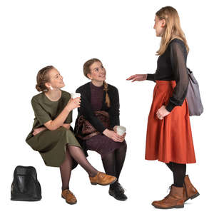 three girls sitting and talking