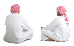 two arab men sitting on the floor and talking