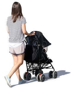 woman in a summer outfit walking with a stroller