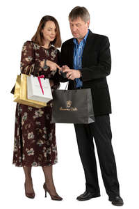 man and woman with shopping bags standing