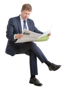 businessman in suit sitting and reading