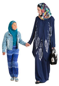 muslim woman walking with her daughter hand in hand