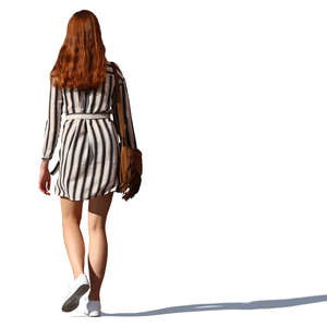 woman with long red hair walking
