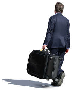 businessman carrying a big suitcase