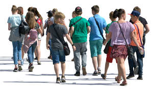 group of young people walking in the summer