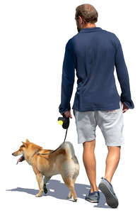 man walking a dog in the summer