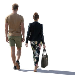 backlit man and woman walking