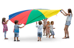 group of children playing with parachute
