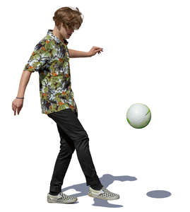 teenage boy juggling a soccer ball