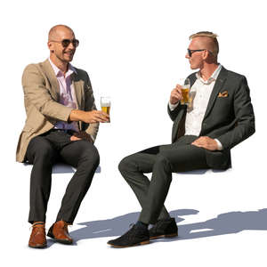 two men sitting and drinking beer