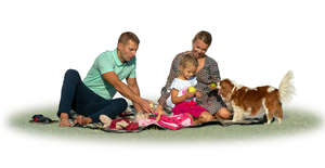 family with a dog having a picnic