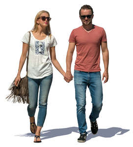 couple walking hand in hand on a sunny day