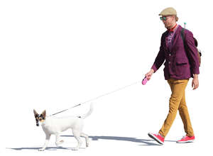 man in a colorful outfit walking a dog
