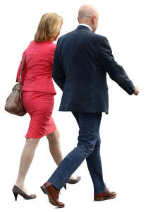 businesswoman and businessman walking