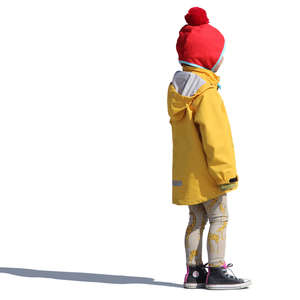 young girl in a yellow raincoat standing