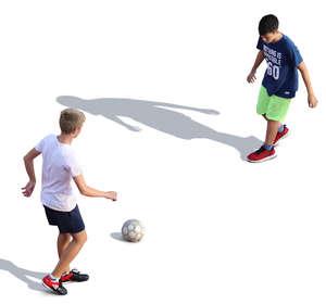 two boys playing football seen from above