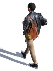 man with a suede backpack walking seen from above