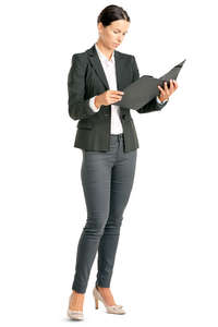 businesswoman standing and looking at some papers