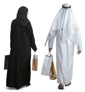 arab couple with shopping bags walking