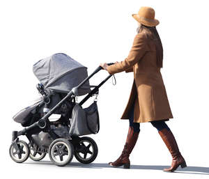 woman in a brown coat walking with a stroller