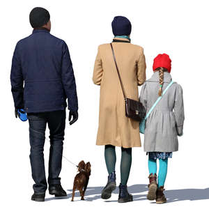 family of three walking with their dog