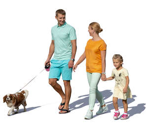 family with a dog walking hand in hand