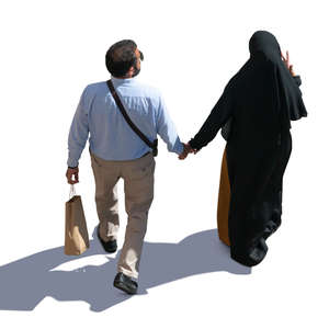muslim man and woman walking hand in hand
