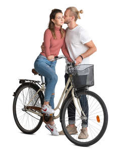 man kissing a woman riding a bike