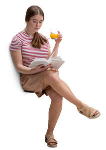 young woman sitting in a cafe and reading