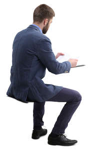 man sitting and reading paperwork